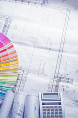 rolled up white blueprints color palette calculator compsotion