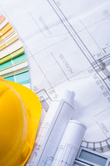 yellow helmet rolled blueprints color palette with copyspace