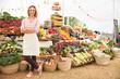 Leinwanddruck Bild - Female Stall Holder At Farmers Fresh Food Market