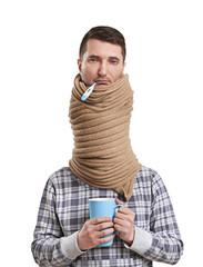 sad man in scarf have a flu
