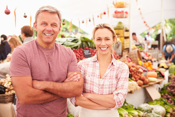 Couple Running Stall At Farmers Fresh Food Market