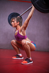 Beauty Woman Athlete Performs Weighlift.