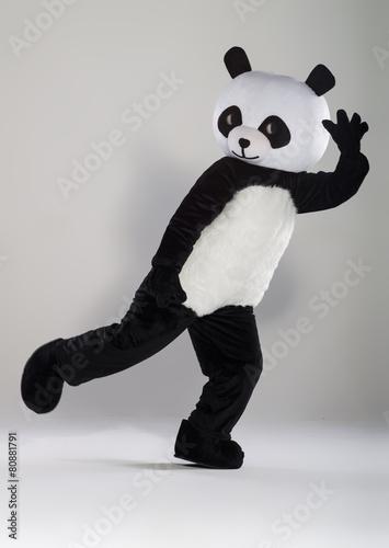 Keuken foto achterwand Panda Man in panda costume over white background
