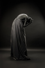 Woman wrapped in black robes