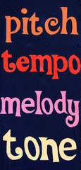 Pitch tempo melody tone painted on a stucco wall.