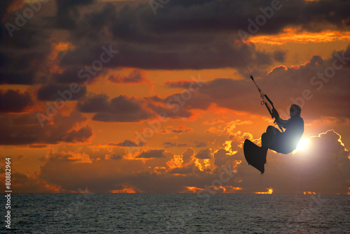 Fotobehang Zeilen Kite surfing at sunset