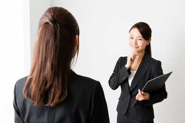 asian businesswomen talking