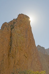 Desert Sun Peeking Around a Rock Monolith