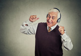 Fototapety elderly man with headphones listening to radio enjoying music