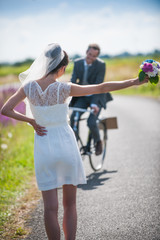 The groom is coming back for his bride on a bike
