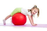 kid girl doing gymnastic exercise with fitball