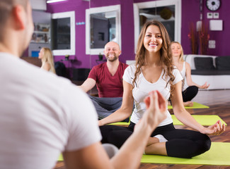 People studying position at yoga