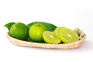Lime in basket. - Stock Image