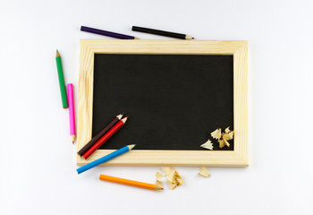 Top view of wooden drawing board and colored pencils