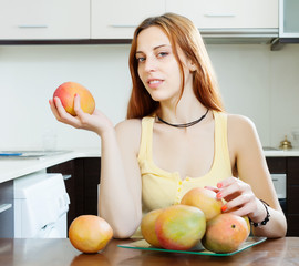 ordinary woman holding  with  mango