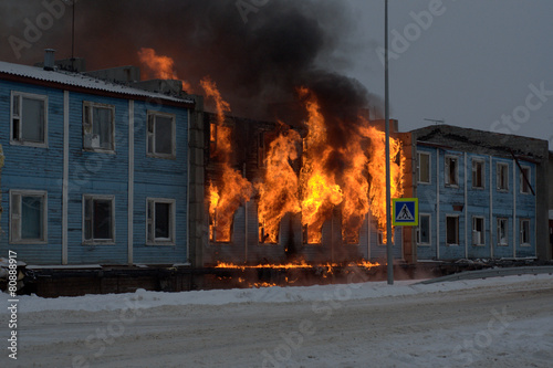 Fire fighters try to save a home - 80888917