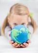 gilrl holding the earth globe