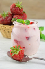 Strawberry yogurt  with fresh fruits and mint leaves