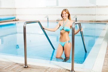 Happy woman at swimming pool