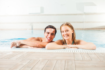 Happy couple in swimming pool
