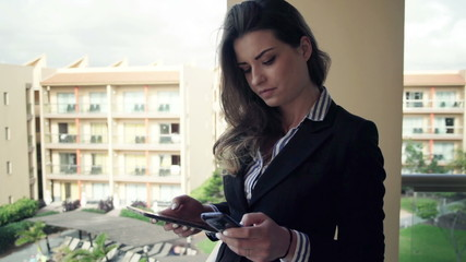 Businesswoman working with tablet computer and smartphone on ter
