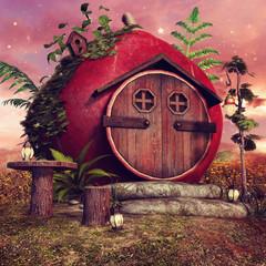 Czerwona chatka elfów z paprocią i lampionami