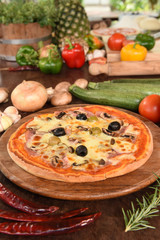 Pizza with ham, mushrooms and olives.