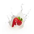 dropping strawberry into milk - 80892107