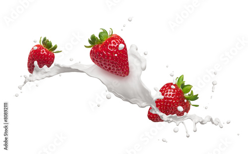 Leinwandbild Motiv strawberries with milk splash