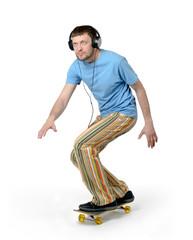 Bearded man with headphones on a skateboard.