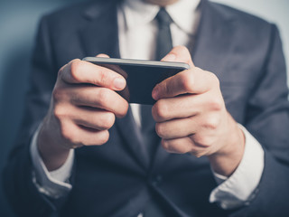 Close up on businessman using smartphone