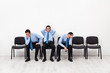 Desperate businessmen sitting on chairs
