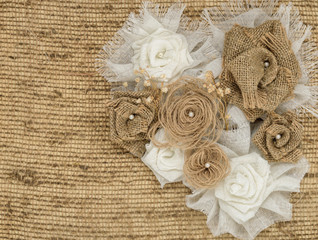 flower rose made of fabric on burlap background