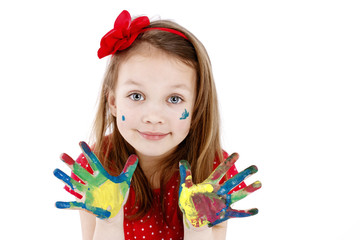 Beautiful little artist with dirty hands and smile on her face