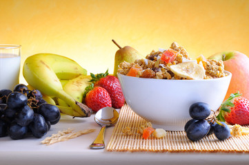 Bowl of cereal and fruits front view