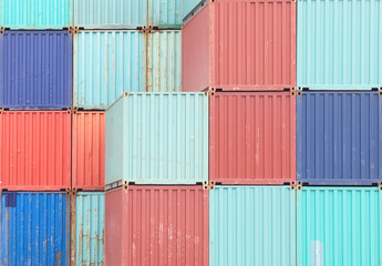 Colorful stack of container shipping at dockyard .