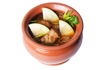 meat with apples in a clay pot for the menu