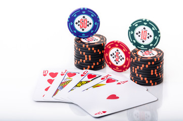 Royal Flush with stacked poker chips on white background