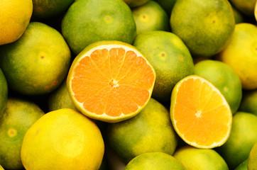 Green mandarin at fruit market