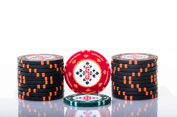 Stacked poker chips isolated on white background