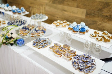 wedding dessert with delicious cakes and macaroons