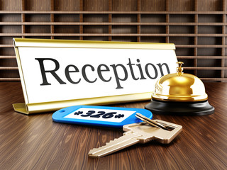 Hotel reception, service bell and room keys