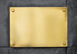 blank gold metal signboard or nameboard on concrete wall - 80899754