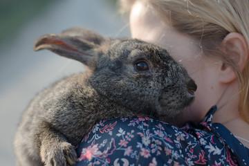 Blonde girl holding easter bunny