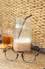 Glasses with bread and tea with ice chocolate
