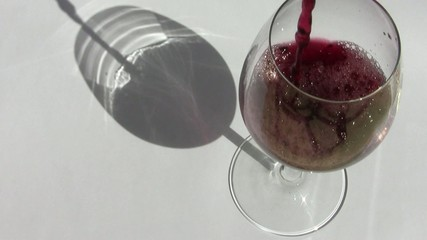 Filling up glass of wine