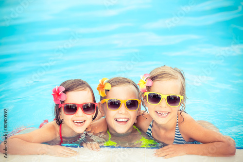 Happy children in the swimming pool - 80900592
