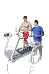Sports Scientist doing Performance Assessment on Treadmill. Mode