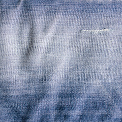Vintage jeans texture with scuffed, jeans background.