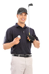 Young man holding a golf club and smiling